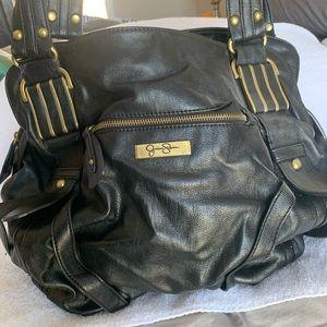 Black Jessica Simpson purse with bronze accent
